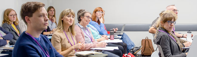 A photograph of attendees at a NALDIC Conference