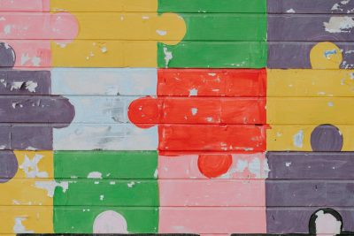 A photo of a coloured jigsaw pattern painted on a wall